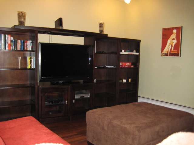 entertainment center with video game console. Black Bedroom Furniture Sets. Home Design Ideas